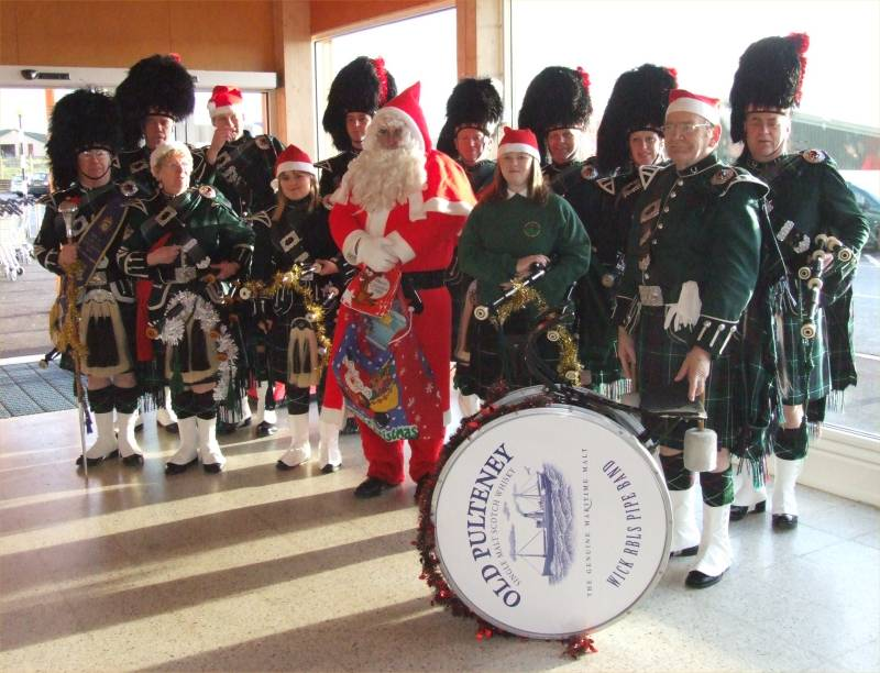 Photo: Pipe Band and Santa At Tesco