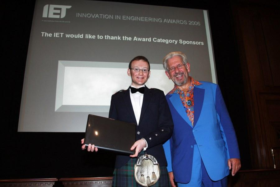 Photo: Erik Mackay Receving His Prize From Adam Hart-Davies
