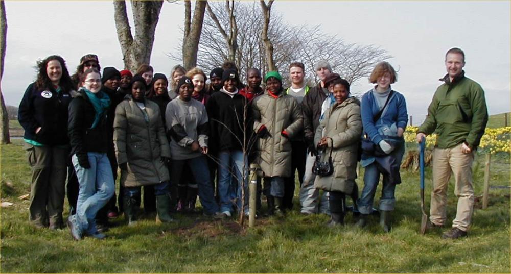 Photo: Global Xchange Volunteers Plant Trees At Riverside Wick