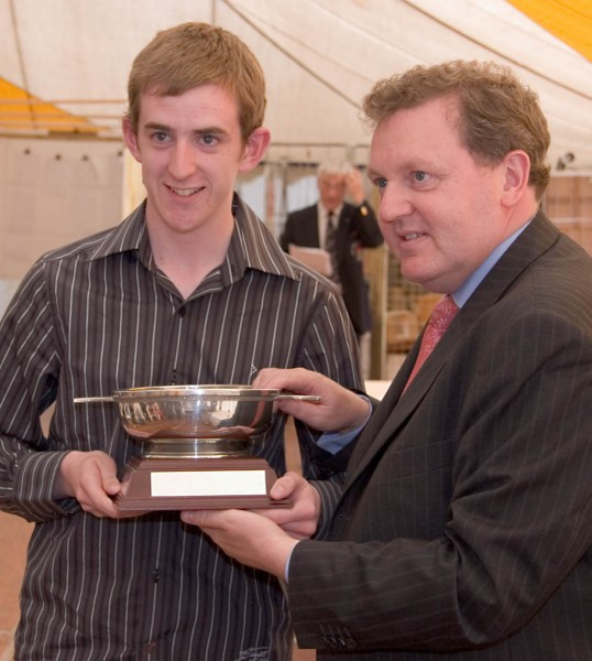 Photo: Gregor Bremner receives his trophy from David Mundell, MP for Dumfriesshire, Clydesdale and Tweeddale
