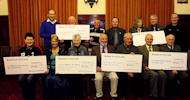 Caithness councillors presenting cheques to local groups