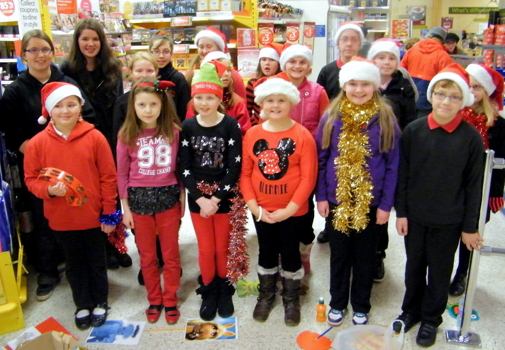 Photo: Caithness and North Sutherland Children's Choir Singing Christmas songs At Tesco