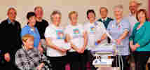 Caithness Heart Support Group present ECg machine to Caithness General.