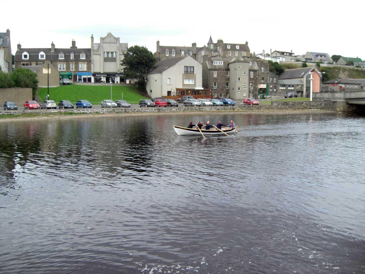 Photo: Wick Coastal Rowing Skiff Heads Up Wick River