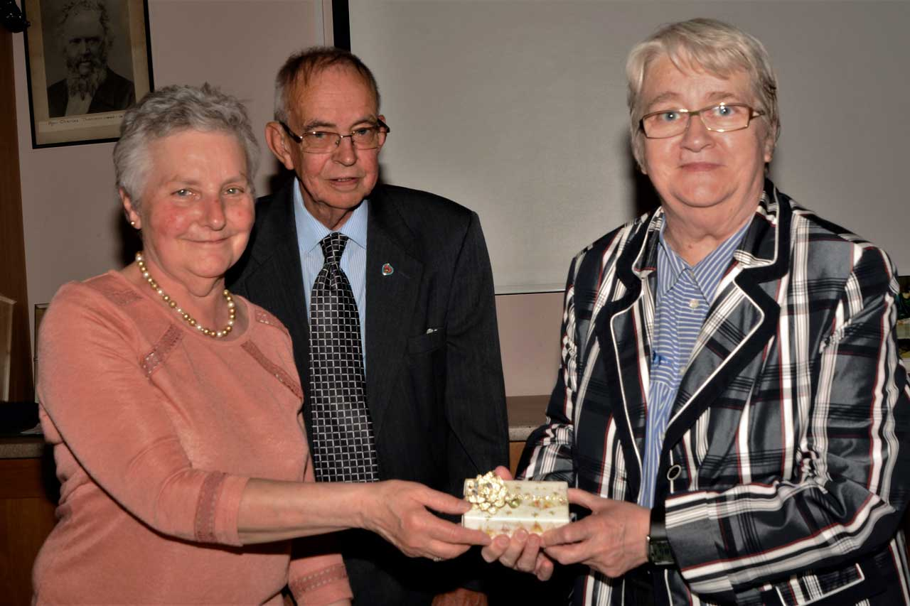 Photo: Retiring group patron, Anne Dunnet receives a gift from secretary Marge Donaldson