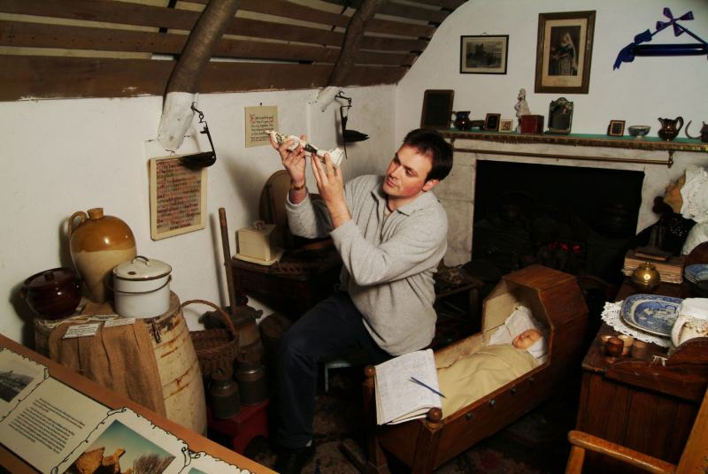 Photo: Alan McIvor, Caithness Horizons Director, Carrying Out An inventory of Thurso Museum Exhibits