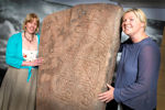 "Curator and Beki Pope, Centre Manager of Caithness Horizons with Class II Pictish symbol stone (800-900AD) known as ""The Ulbster Stone"""