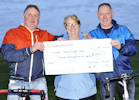 Cheque from cyclists for Caithness Heart Support group.