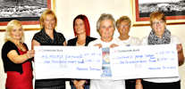 Marge donaldson presnts cheques from her West Highland Way charity walk
