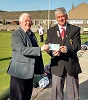 Bill Fernie chairmanof Laurandy Day Care Centre receives £300 from Malky Mackay chairman of St Fergus Bowling Club Wick