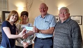 Maureen and Gordon Doull present £750 to CHAT - Nicola Sinclair and Bill Fernie