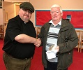 Rev.John Nugent handing over Cash donation to CHAT Chairman Bill Fernie